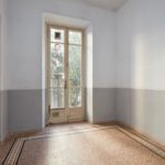 Empty room interior with tiled floor and old window with balcony